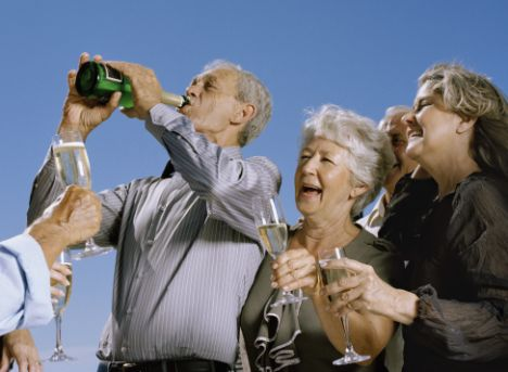 Seniors Drinking Champagne