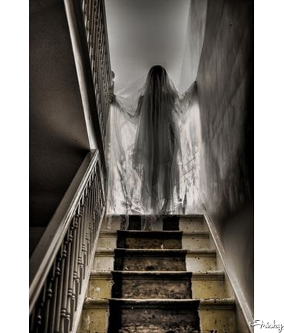 Gauze-Draped-Mannequin-In-The-Stairwell-400x470